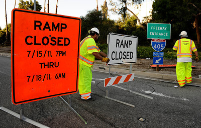 Workers start to closed the on ramps of the south bound 405 freeway at Ventura Blvd as the start of the carmageddon weekend begins in Encino CA. July 15,2011. Photo by Gene Blevins/LA Daily News