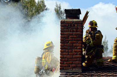 Los Angeles CIty  and County firefighters battle a house fire in the 21900 block of Woodland Crest Dr. in Woodland Hills, CA.  Tuesday, April 12, 2011. (Hans Gutknecht/Staff Photographer)