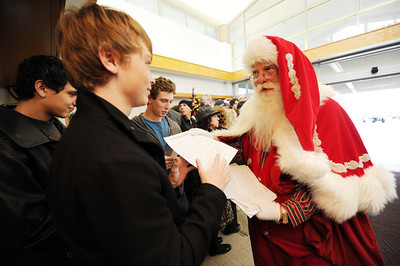 Brady White a.k.a. Santa to the Stars hands out lyrics to carolers. Celebrities and entertainment-industry executives prepare sang Christmas carols and distribute gifts to patients, visitors and staff at the Motion Picture & Television Fund hospital Thursday, December 23, 2010 in Woodland Hills Ca. The event was organized by actors Renee Taylor, Joe Bologna, Connie Stevens and Diane Ladd. (Hans Gutknecht/Staff Photographer)