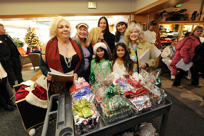 Celebrities and entertainment-industry executives prepare to sing Christmas carols and distribute gifts to patients, visitors and staff at the Motion Picture & Television Fund hospital Thursday, December 23, 2010 in Woodland Hills Ca. The event was organized by actors Renee Taylor, Joe Bologna, Connie Stevens and Diane Ladd. (Hans Gutknecht/Staff Photographer)