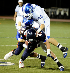 Chaminade's #47 Jess Reed gets double team by Burbank defense, during friday night football. Sept 10,2010. Photo by Gene Blevins/LA Daily News