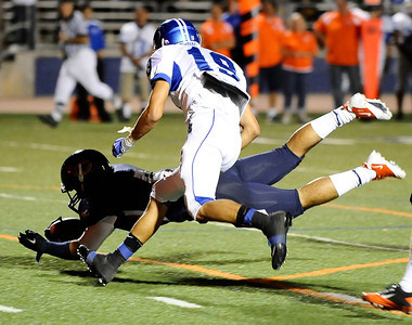 Chaminade's #5 Tru Jarvis dives for the 1st down as they play Burbank high during friday night football. Sept 10,2010. Photo by Gene Blevins/LA Daily News