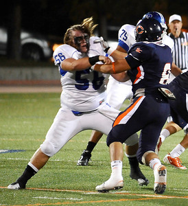 Burbank high #56 Spencer Lee keeps blocking after getting his helmet knock off, during friday night football with Chaminade. Sept 10,2010. Photo by Gene Blevins/LA Daily News