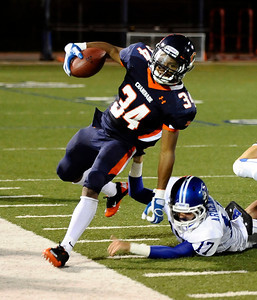 Chaminade's #34 Terrell Newby gets push out of bounds during friday night football. Sept 10,2010. Photo by Gene Blevins/LA Daily News