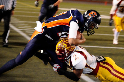 Chatsworth's QB Curtis Ervin gets drilled by Fairfax #2 Don Tyler Jr. at the sidelines, as they play Fairfax high in City Section Div. II football final CIF. Los Angeles. Dec 10,2010. Photo by Gene Blevins/LA Daily News