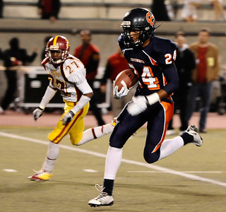 Chatsworth's #24 Eric Waters breaks through the Fairfax defense to score the 1st touchdown of the game, as they play Fairfax high in City Section Div. II football final CIF. Los Angeles. Dec 10,2010. Photo by Gene Blevins/LA Daily News