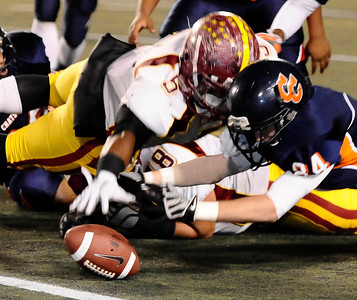 (L) Chatsworth's #84 Kyle Haupt tries to get the fumble ball from Fairfax #5 Matt Bowen Jr. , as they play Fairfax high in City Section Div. II football final CIF. Los Angeles. Dec 10,2010. Photo by Gene Blevins/LA Daily News
