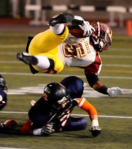 Chatsworth's #7 Jordon Osburn knocks Fairfax #5 Matt Bowen Jr. airborne, as they play Fairfax high in City Section Div. II football final CIF. Los Angeles. Dec 10,2010. Photo by Gene Blevins/LA Daily News