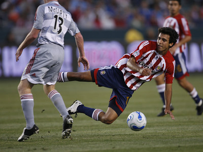 Chivas Jonathan Bornstein falls to the ground for control of ball against Dallas Dax McCarty during the first half of the game on Saturday, May 26, 2007 at Home Depot Center in Carson, Ca. (Edna T. Simpson)