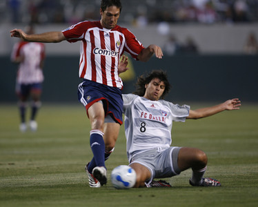Chivas Ante Razov battles for control of ball against Dallas Juan Toja during the first half of the game on Saturday, May 26, 2007 at Home Depot Center in Carson Ca. (Edna T. Simpson)