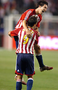 Chivas USA's Sacha Kljestan jumps on teammate Ante Razov after Razov scored the final goal in against FC Dallas Saturday night at the Home Depot Center in Carson. May 26, 2007.(Staff photo by Sean Hiller).