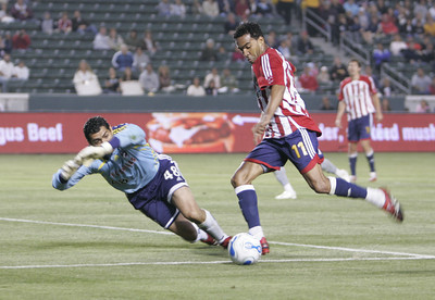 Chivas Maykel Galindo kicks the ball in front of Dallas GK Dario Sala during the first half of the game on Saturday, May 26, 2007 at Home Depot Center in Carson Ca. (Edna T. Simpson)