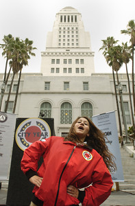 Tiffany Taubman, 22, of West Hills, Ca., leads exercise in front of City Hall of opening day of City Year Los Angeles, a volunteer community group, on Friday morning, Sept. 28, 2007.  (Tina Burch/Staff Photographer)