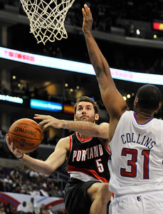 Rudy Fernandez drives past Clippers Jarron Collins. The Clippers were defeated by the Portland Trail Blazers 98 to 88 in the season opener at Staples Center in Los Angeles, CA.10-27-2010. (John McCoy/staff photographer)