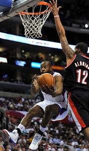 Clippers Baron Davis drives past LaMarcus Aldridge. The Clippers hosted the Portland Trail Blazers in the season opener at Staples Center in Los Angeles, CA.10-27-2010. (John McCoy/staff photographer)