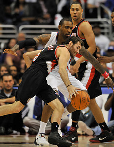 Rudy Fernandez drives the ball past Clippers Ryan Gomes. The Clippers hosted the Portland Trail Blazers in the season opener at Staples Center in Los Angeles, CA.10-27-2010. (John McCoy/staff photographer)