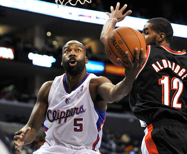 Clippers Barron Davis drives past Blazers LaMarcus Aldridge. The Clippers hosted the Portland Trail Blazers in the season opener at Staples Center in Los Angeles, CA.10-27-2010. (John McCoy/staff photographer)