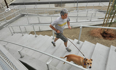 Frank Bruynbroek  runs up the stairway with his dog at the now open to traffic the Colfax Avenue bridge Thursday morning, as the two-year project to widen and modernize the overpass comes to a completion. Studio City, CA. July 28,2011. photo by Gene Blevins/LA Daily News