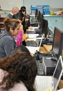 Computers for Youth Los Angeles Launch Family Learning Workshop as parents and children work together and then take their home learning center with them at the end of the day at William Mulholland Middle School in Van Nuys. Dec 4 ,2010. Photo by Gene Blevins/LA Daily News