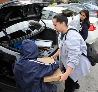 (C) Jenenne Macias helps her kids taking home a computer after the Computers for Youth Los Angeles Launch Family Learning Workshop as parents and children work together and then take their home learning center with them at the end of the day at William Mulholland Middle School in Van Nuys. Dec 4 ,2010. Photo by Gene Blevins/LA Daily News