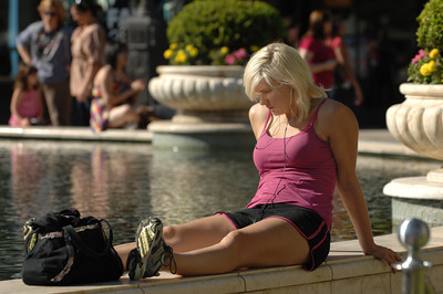 Christy Callahan, 23, of Silver Lake ventured over to the Americana at Brand to soak up some rays of sunshine next to the reflecting pool and fountain. Cool temperatures made for a very comfortable month of July, one of the coolest summer months on record. Glendale, CA 07/28/2010 (John McCoy/Staff Photographer)