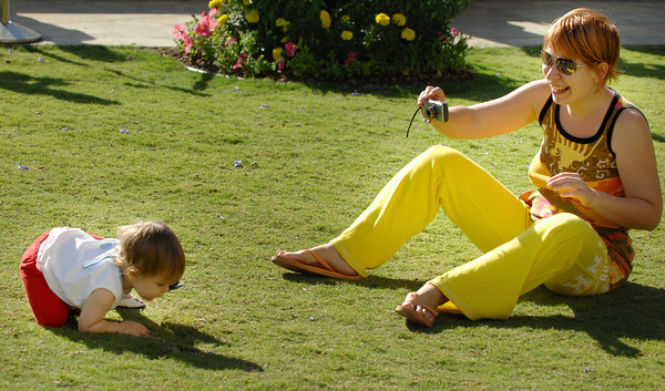 Monica Radulescv playes with her 1-year-old daughter Talia on the grass at the Americana at Brand. Cool temperatures made for a very comfortable month of July, one of the coolest summer months on record. Glendale, CA 07/28/2010 (John McCoy/Staff Photographer)