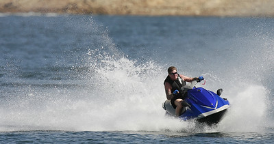 Mike DeFreest of Granada Hills makes a big splash while turning as heÊrides his personal water craft at the Upper Castaic Lake in Castaic, CA, on Sunday, July 22, 2007. (John Lazar/L.A. Daily News Staff Photographer)