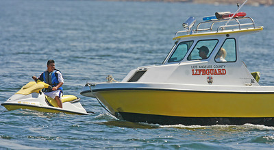 L.A. County Lifegaurd warn a rider of the water rules after stopping him for speeding through the 5 mph limit wake zone at the Upper Castaic Lake in Castaic, CA, on Sunday, July 22, 2007. (John Lazar/L.A. Daily News Staff Photographer)