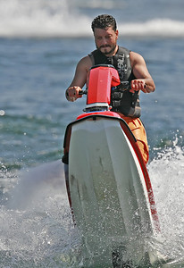 Kevin Carrafiello of Canyon Country launches hisÊJetSki out of the water as he rides at the Upper Castaic Lake in Castaic, CA, on Sunday, July 22, 2007. (John Lazar/L.A. Daily News Staff Photographer)