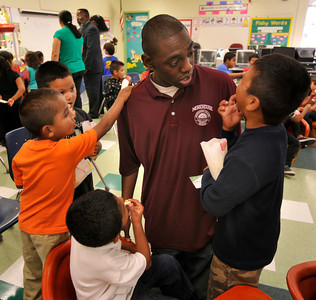 "Seth Fowler talks to kids after reading from his book. Fowler is a Woodland Hills resident who is enrolled at Morehouse College. When he was 9-years old, he wrote an illustrated a book ""Cory the Popcorn's Big Adventure,"" that has since been published. He was invited to read an excerpt from his book at 75th Street Elementary School. Los Angeles, CA 08/04/2010 (John McCoy/Staff Photographer)"