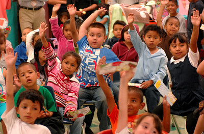 "Children raise their hands after listening to Seth Fowler read from his book. Fowler is a Woodland Hills resident who is enrolled at Morehouse College. When he was 9-years old, he wrote an illustrated a book ""Cory the Popcorn's Big Adventure,"" that has since been published. He was invited to read an excerpt from his book at 75th Street Elementary School. Los Angeles, CA 08/04/2010 (John McCoy/Staff Photographer)"