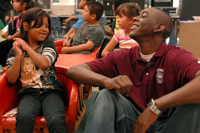 "Destiny Leyva,7, talks with Fowler after he read from his book. Seth Fowler is a Woodland Hills resident who is enrolled at Morehouse College. When he was 9-years old, he wrote an illustrated a book ""Cory the Popcorn's Big Adventure,"" that has since been published. He was invited to read an excerpt from his book at 75th Street Elementary School. Los Angeles, CA 08/04/2010 (John McCoy/Staff Photographer)"