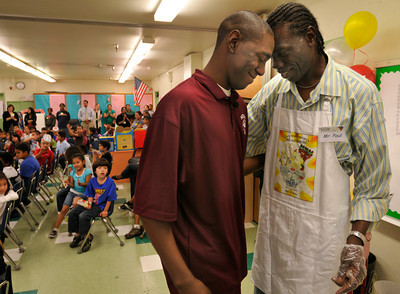 "Seth Fowler has a moment with his father Paul after reading from his book. Seth Fowler is a Woodland Hills resident who is enrolled at Morehouse College. When he was 9-years old, he wrote an illustrated a book ""Cory the Popcorn's Big Adventure,"" that has since been published. He was invited to read an excerpt from his book at 75th Street Elementary School. Los Angeles, CA 08/04/2010 (John McCoy/Staff Photographer)"