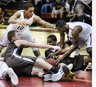 Crespi #4 Michael Avery and #2 Maasai Ephriam were on the bottom of the pile battling for the ball in the final seconds with Alemany #10 Max Guercy and #2 Jerico Richardson.  Crespi defeated Alemany 60-55 in a Mission League first-place showdown in the Alemany gym. Mission Hills,  CA 1/11/2012(John McCoy/Staff Photographer)
