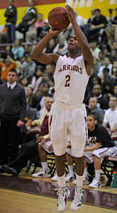 Alemany #2 Jerico Richardson takes a jumper. Crespi defeated Alemany 60-55 in a Mission League first-place showdown in the Alemany gym. Mission Hills,  CA 1/11/2012(John McCoy/Staff Photographer)