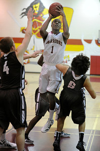 Alemany #1 Marqueze Coleman shoots over Crespi#4 Michael Avery and Crespi#5 Christian Johnson. Crespi defeated Alemany 60-55 in a Mission League first-place showdown in the Alemany gym. Mission Hills,  CA 1/11/2012(John McCoy/Staff Photographer)