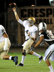 Notre Dame QB Kelly Hilinski #4 passes the ball during their game against Crespi at Crespi High School Friday, October 14, 2011. (Hans Gutknecht/Staff Photographer)