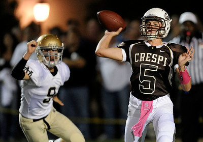 Crespi QB Cody Cordell #5 passes the ball during their game against Notre Dame at Crespi High School Friday, October 14, 2011. (Hans Gutknecht/Staff Photographer)
