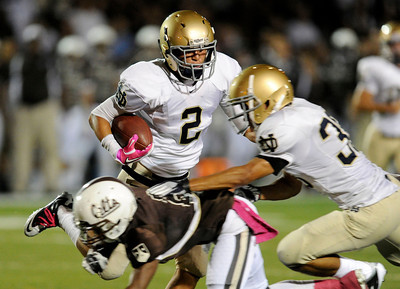 Notre Dame's Kevin Carrasco #2 heads for the end zone for a touchdown after intercepting a Crespi pass during their game against Crespi at Crespi High School Friday, October 14, 2011. (Hans Gutknecht/Staff Photographer)
