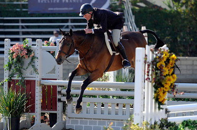Paul Rohrbach competes during the first day of the $50,000 Los Angeles NationalÊGrand Prix Wednesday, November 16, 2011 at theÊLos Angeles Equestrian Center in Burbank, CA. The event concludes on Saturday top riders competing in show jumping in the Equidome atÊthe Equestrian Center (Hans Gutknecht/Staff Photographer)