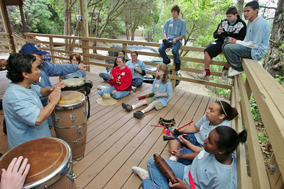 A group of teens get lessons in percussion instruments which was one of a hand-full of activities available to them on Saturday, June 2, 2007 during a three-day camp at Camp Hess Kramer in Malibu, CA, offered by the House Ear Institute which promotes hearing research and education for families with children who are deaf or have partial hearing loss. Kids participated in activities such as the aquarium touch tank and a wildlife presentation along with acting and percussion workshops with peers who share their disability while their parents gathered for support sessions to learn about new developments in dealing with hearing loss.  (John Lazar/L.A. Daily News Staff Photographer)