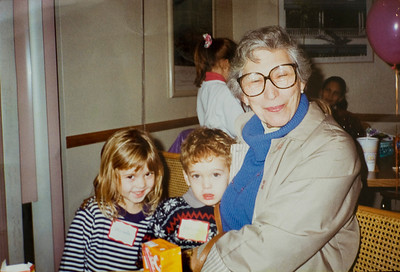 A photograph courtesy of Lori Moore, taken an estimated 20 years ago of Andrew Moore's sister, Shelly Schoen, Moore, and Toby Zablen. Zablen, 97, helped the Moore family 20 years ago, taking care of 21-year-old and Cal State Northridge senior Andrew Moore beginning when he was two. The Moores frequently visit Zablen at Royal Garden, an assisted living facility in Valley Glen, Calif.  (Maya Sugarman/Staff Photographer)