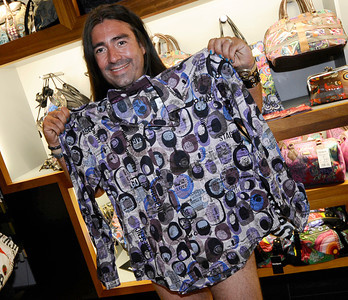 Peter Rosales Delmota shows one of his  free shirts at  the Desigual spanish apparel brand store at the start of the undie party that started at 9 am. this morning The first 100 people arriving at DesigualÕs new Third Street Promenade store in Santa Monica Ðwearing just their underwear Ð will walk out in a free two-piece Desigual outfit . Santa Monica CA.Aug 30,2011 photo by Gene Blevins/LA DailyNews