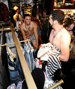 The first people 100 people ransack through the Desigual spanish apparel brand store at the start of the undie party that started at 9 am. this morning The first 100 people arriving at DesigualÕs new Third Street Promenade store in Santa Monica Ðwearing just their underwear Ð will walk out in a free two-piece Desigual outfit . Santa Monica CA.Aug 30,2011 photo by Gene Blevins/LA DailyNews
