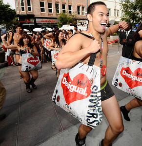 The first people make a mad dash into the Desigual spanish apparel brand store at the start of the undie party that started at 9 am. this morning The first 100 people arriving at DesigualÕs new Third Street Promenade store in Santa Monica Ðwearing just their underwear Ð will walk out in a free two-piece Desigual outfit . Santa Monica CA.Aug 30,2011 photo by Gene Blevins/LA DailyNews