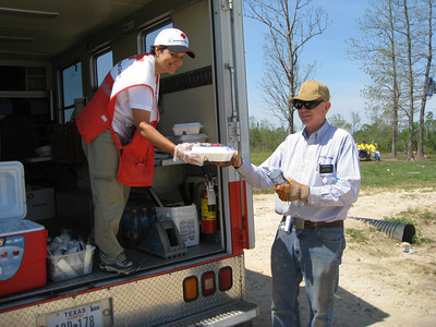 Red Cross Volunteer Sandy Hanagami provides mobile feeding to survivors of the Alabama tornadoes.