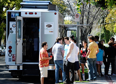 Food Trucks line up along 28th st. near USC during The Dish Dash L.A. inaugural food truck Wars to benefit Union Rescue Mission and Paws LA. Up to 10 food trucks served their cuisine to customers and collage students. Los Angeles CA. March 25,2011. Photo by Gene Blevins/LA Daily News