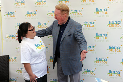 Dodger broadcaster Vin Scully says hello to Janet Dang at Angeles National Golf Course Monday, April 25, 2011. Scully was on hand for the  'Tee off for Tierra' charity golf tournament. The proceeds from the event benefit people with developmental disabilities at Tierra del Sol Foundation.  Tierra del Sol helps more than 500 people across Los Angeles County overcome cognitive, physical, emotional or behavioral challenges resulting from developmental disability.  (Hans Gutknecht/Staff Photographer)