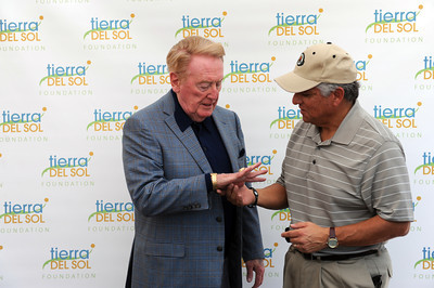 Louis Lopez, Porter Ranch, takes a look at legendary broadcaster Vin Scully's 1988 Dodgers World Series championship ring at Angeles National Golf Course Monday, April 25, 2011. Scully was on hand for the  'Tee off for Tierra' charity golf tournament. The proceeds from the event benefit people with developmental disabilities at Tierra del Sol Foundation.  Tierra del Sol helps more than 500 people across Los Angeles County overcome cognitive, physical, emotional or behavioral challenges resulting from developmental disability.  (Hans Gutknecht/Staff Photographer)