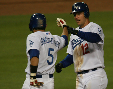 Los Angeles Dodgers' Jeff Kent, right, high-fives teammate Nomar Garciaparra after hitting a two-run homer in the third inning against the Cubs in the game played on Friday, May 25, 2007 in Los Angeles, CA.  John Lazar / L.A. Daily News Staff Photographer